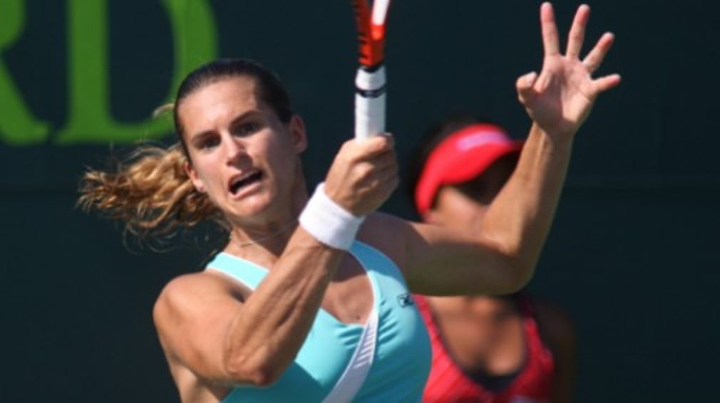Amelie Mauresmo turns back the years to see off young upstart Alize Cornet in the first round at Eastbourne.