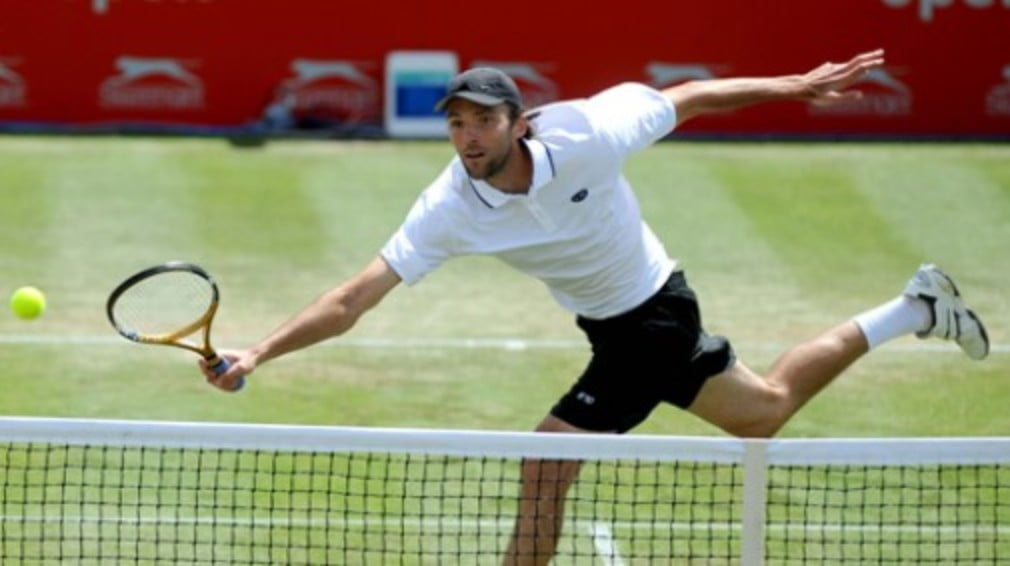 The traditional British summer forced the final day's action at the Slazenger Open under the roof...