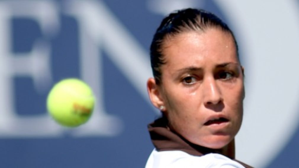 World No.1 Jelena Jankovics 12-match winning streak is ended by Italian Flavia Pennetta at the Zurich Open on Thursday.