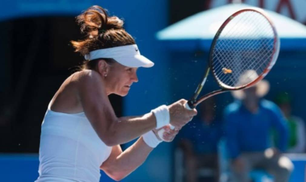 Casey DellacquaŠ—Ès run at the Australian Open continued as she reached the fourth round of a Grand Slam for the first time since 2008