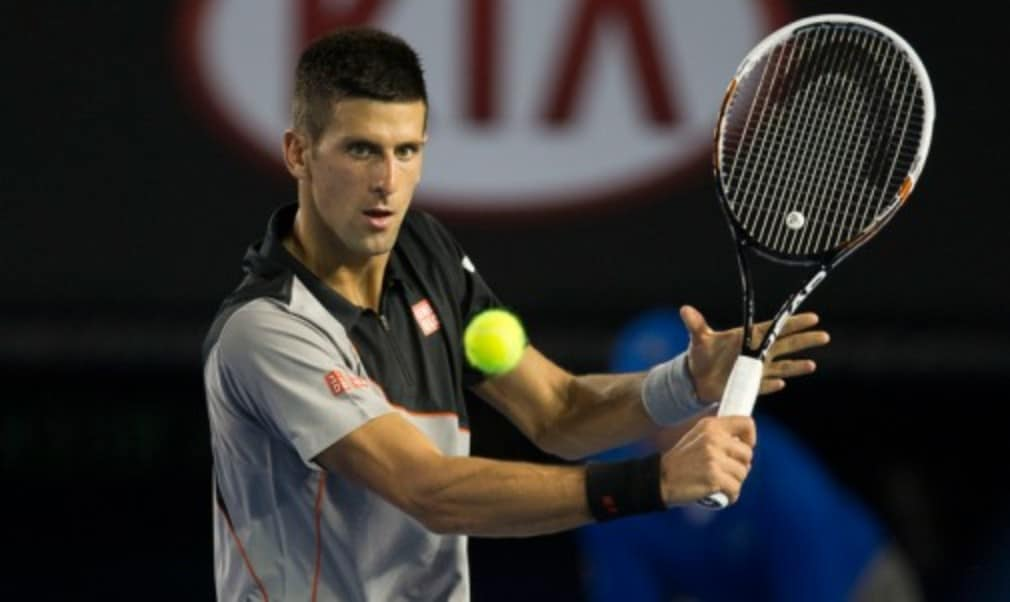 Novak Djokovic beat Denis Istomin in straight sets under the Rod Laver Arena roof to make the Australian Open fourth round