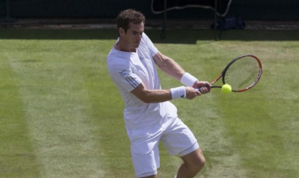 Andy Murray says he is thriving on the pressure at Wimbledon after completing an almost flawless first week with an impressive win over Roberto Bautista Agut