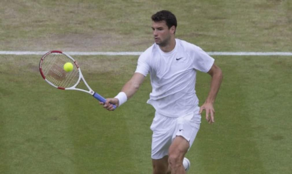 Grigor Dimitrov ended Andy Murray's reign as Wimbledon champion with a comprehensive victory on Centre Court