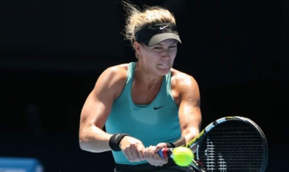 Eugenie Bouchard ended her wait for a first win since the Wimbledon final at the Connecticut Open as Sam Stosur battled her way past Kurumi Nara