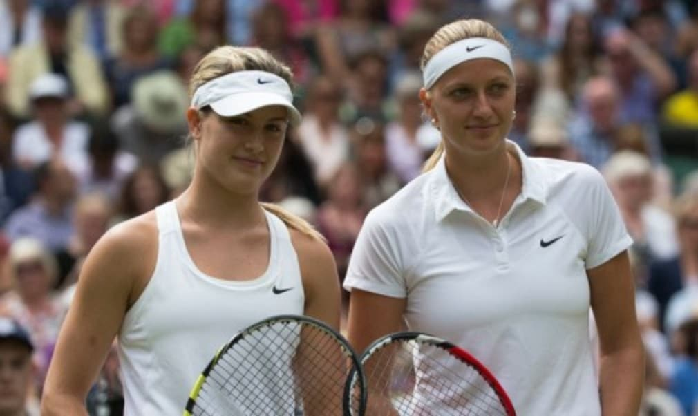 Last yearŠ—Ès ladies singles finalists could not have suffered more contrasting fates on Tuesday as Petra Kvitova breezed through her opening match in straight sets before an injured Eugenie Bouchard crashed out