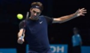 Roger Federer qualified for the semi-finals of the Barclays ATP World Tour Finals after bringing Novak DjokovicŠ—Ès three-year indoor winning streak to an end with victory over the world No.1 in London
