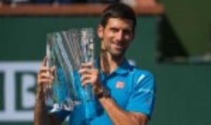 Novak Djokovic became the first man to win five titles in Indian Wells as he defeated Milos Raonic to defend his BNP Paribas Open crown in California
