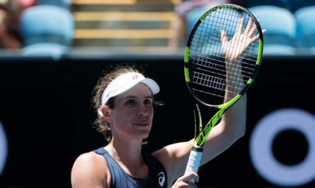 BritainŠ—Ès Johanna Konta overcame a stern test in her first round match against Kirsten Flipkens