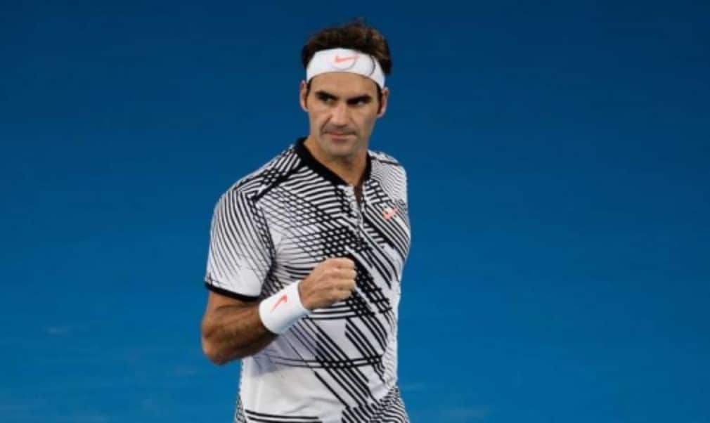 Roger Federer reached his first Australian Open final in seven years as he survived a fightback by Stan Wawrinka