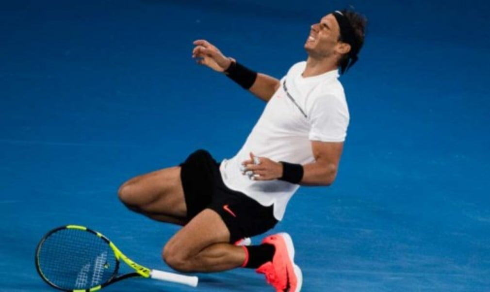 Rafael Nadal booked a much-anticipated Australian Open final date with Roger Federer after the Spaniard outlasted Grigor Dimitrov in five sets