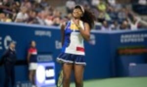 Naomi Osaka grabbed the headlines on a rain-interrupted day two of the US Open as she blasted her way past the defending champion Angelique Kerber 6-3 6-1 in just 64 minutes