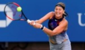 Petra Kvitova was the first woman to book her place in the fourth round of the US Open when she defeated Caroline Garcia for the loss of only four games
