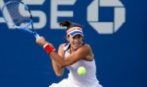 Garbine Muguruza set up a mouth-watering fourth round clash with Petra Kvitova at the US Open after recording an emphatic 6-1 6-1 victory over Magdalena Rybarikova in 61 minutes