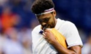 Jo-Wilfried Tsonga is safely through to the quarter-finals of the St. Petersburg Open after a 7-6(1) 3-6 6-2 win over Joao Sousa