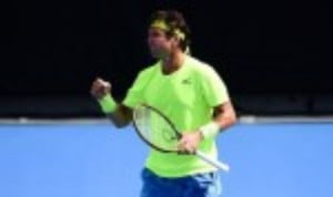 Malek Jaziri sprung a surprise at the Dubai Duty Free Tennis Championships by recovering from a set down to defeat Grigor Dimitrov 4-6 7-5 6-4