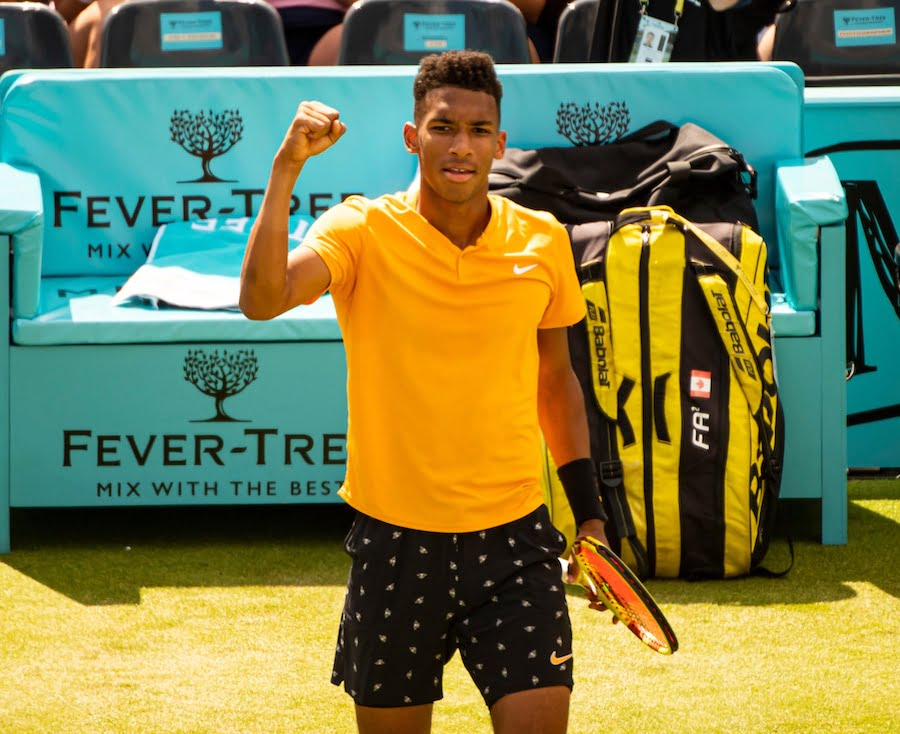 Felix Auger-Aliassime plays on grass at Queens Club