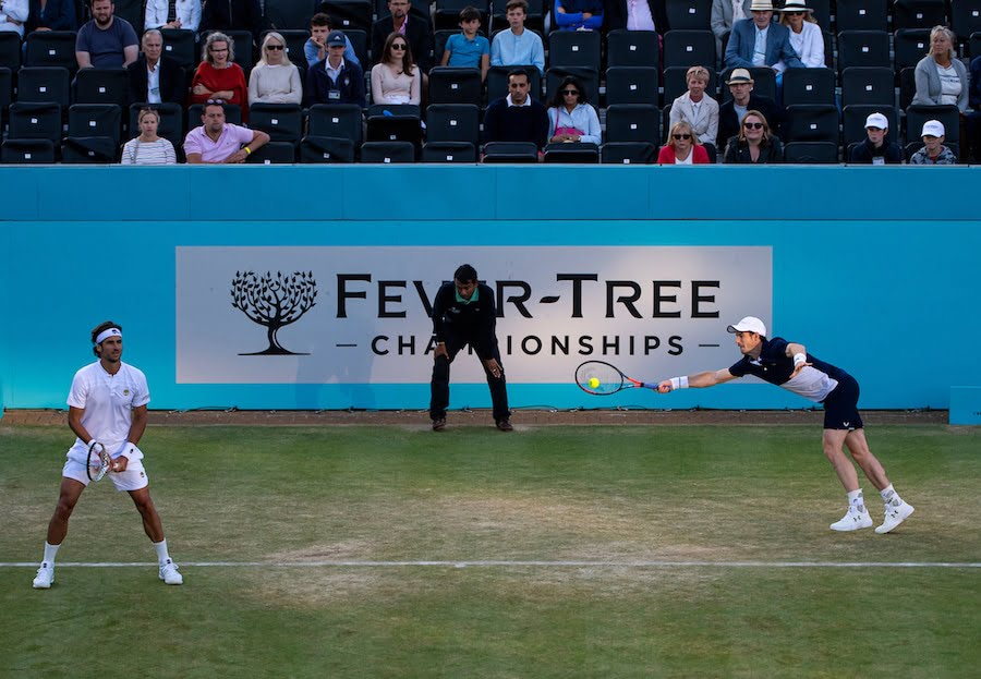 Andy Murray dives to return during doubles match at Queens