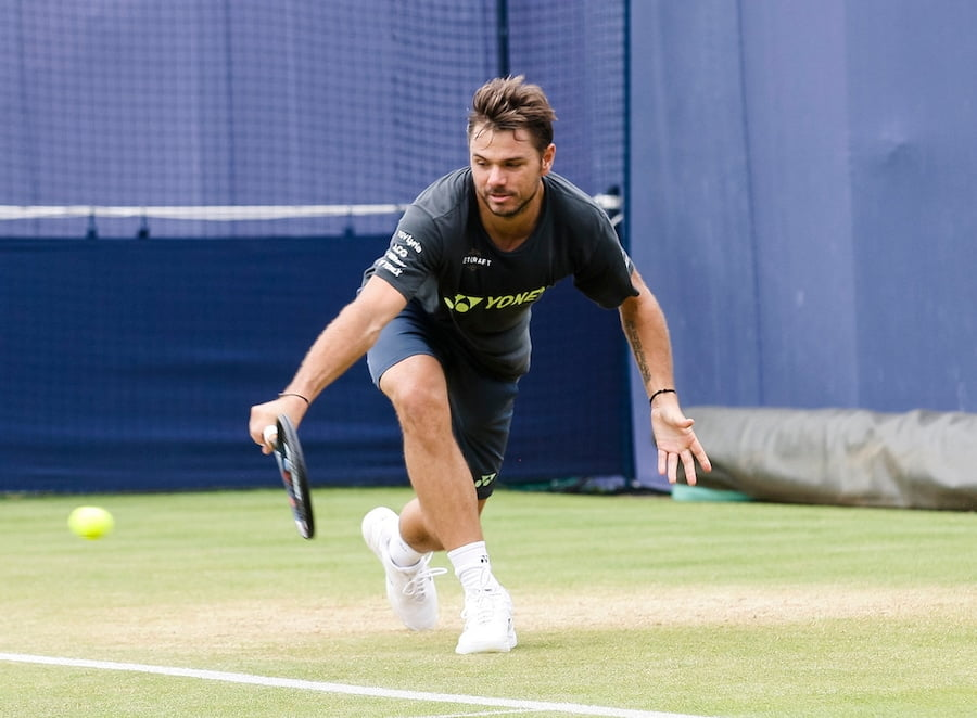 Wawrinka hits a backhand on grass