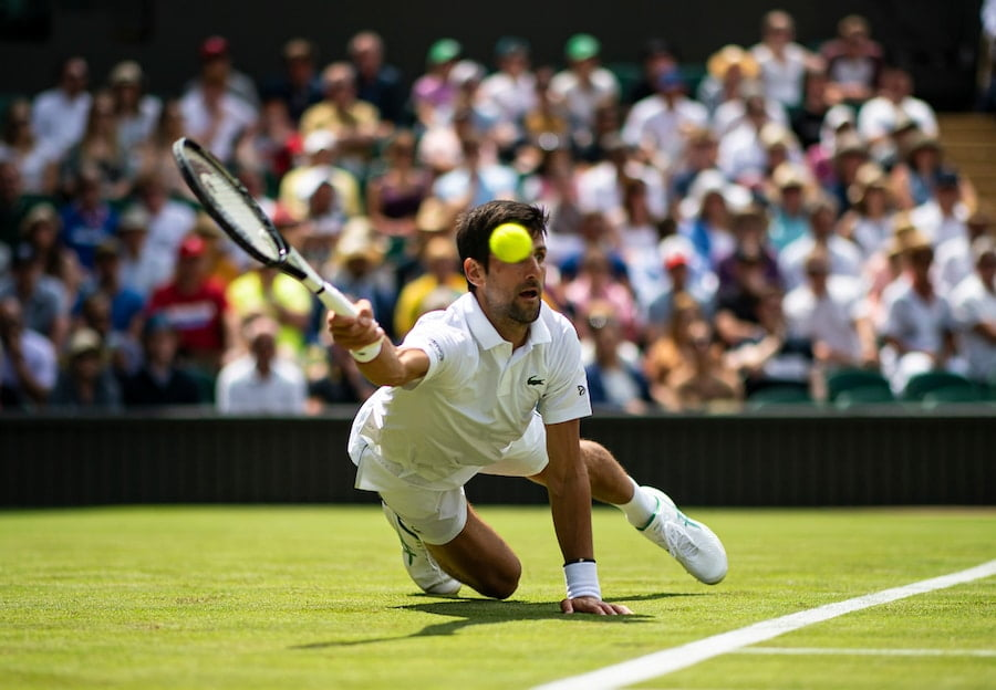 Novak Djokovic Wimbledon 2019 diving for shot