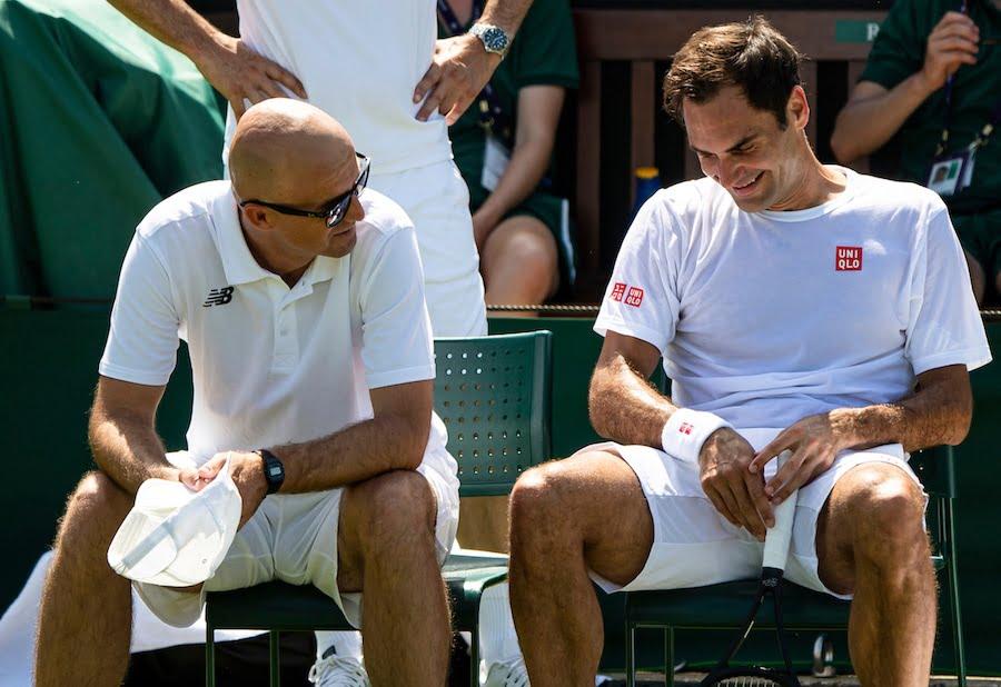 Federer laughs during practise at Wimbledon 2019