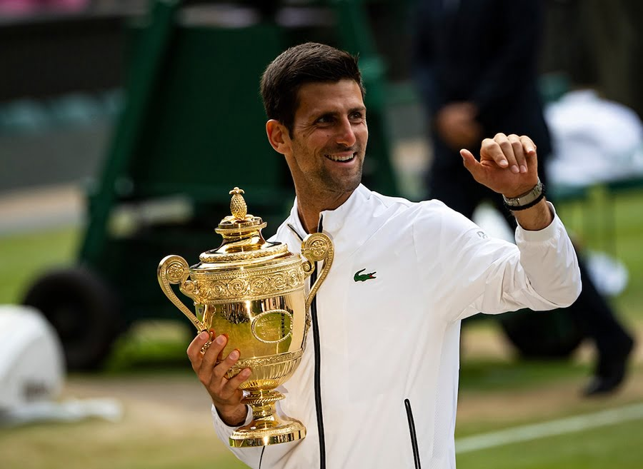 Novak Djokovic Wimbledon trophy after beating Roger Federer