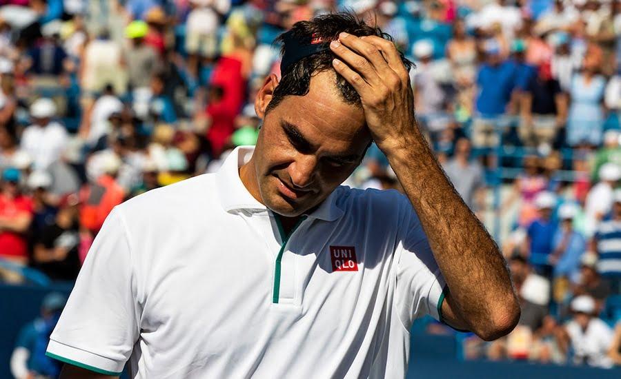 Roger Federer holding head