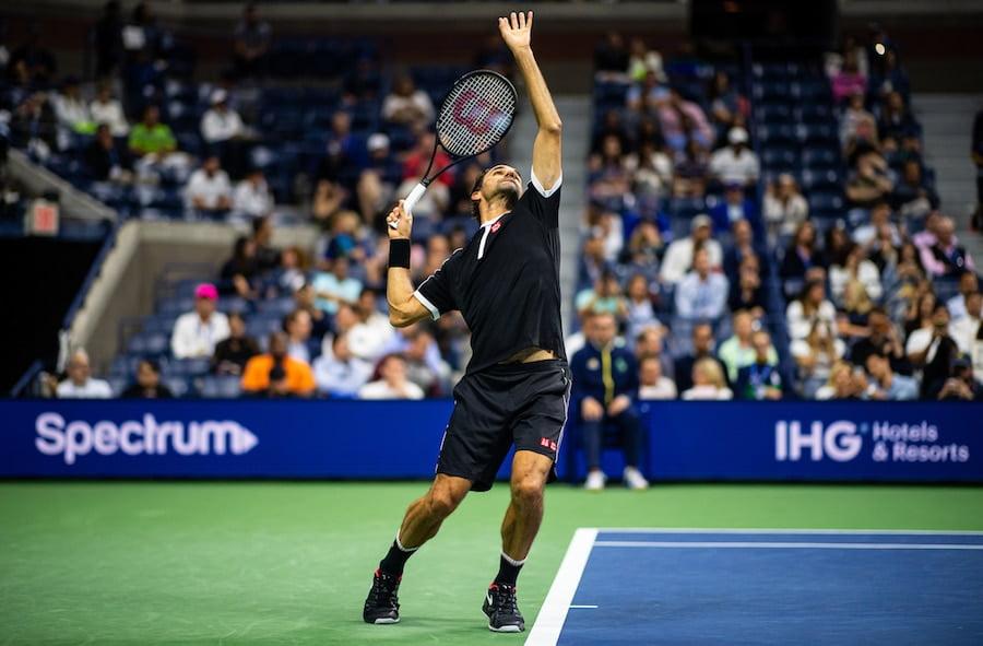Roger Federer serves at US Open 2019