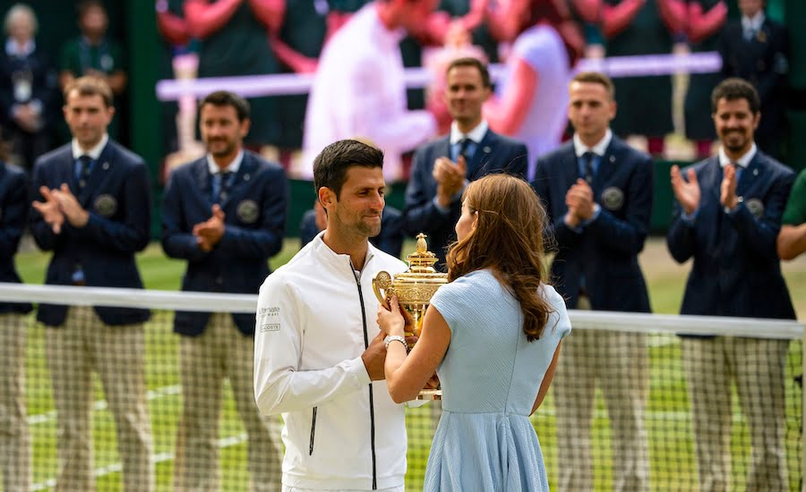 Novak Djokovic accepts Wimbledon 2019 trophy from Duchess of Cambridge.jpg