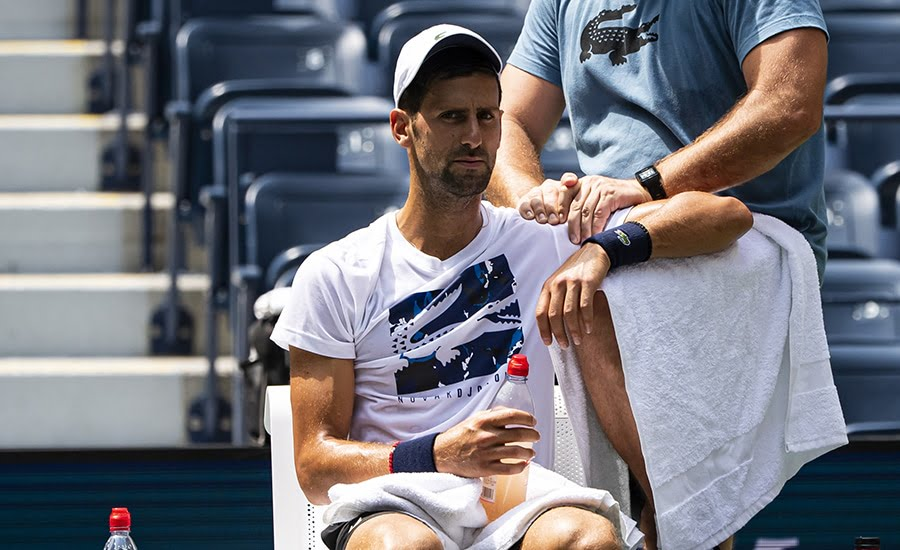 Novak Djokovic receiving treatment