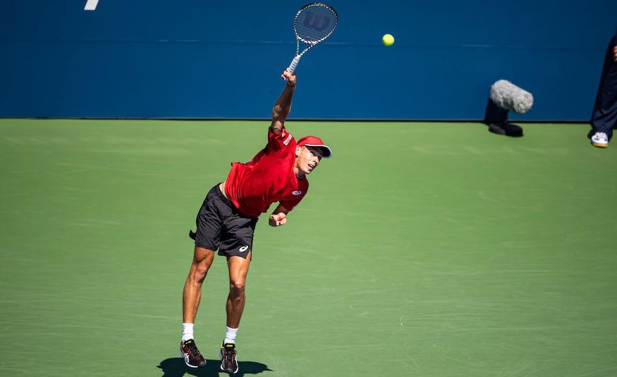 Alex de Minaur serves at US Open 2019