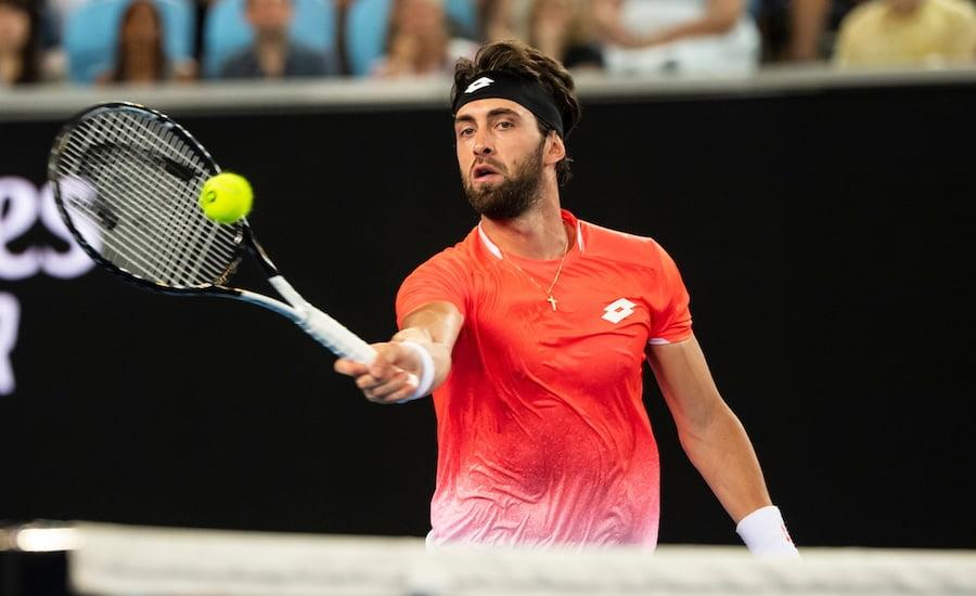 Nikoloz Basiliashvili plays a forehand volley at the Australian Open