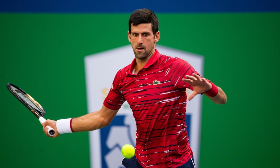Novak Djokovic focusses on a forehand at Shanghai 2019