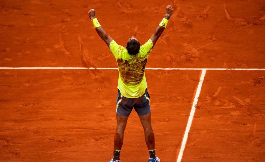 Rafa Nadal arms aloft Roland Garros 2019