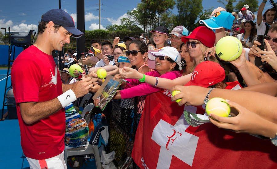 Roger Federer signs autographs