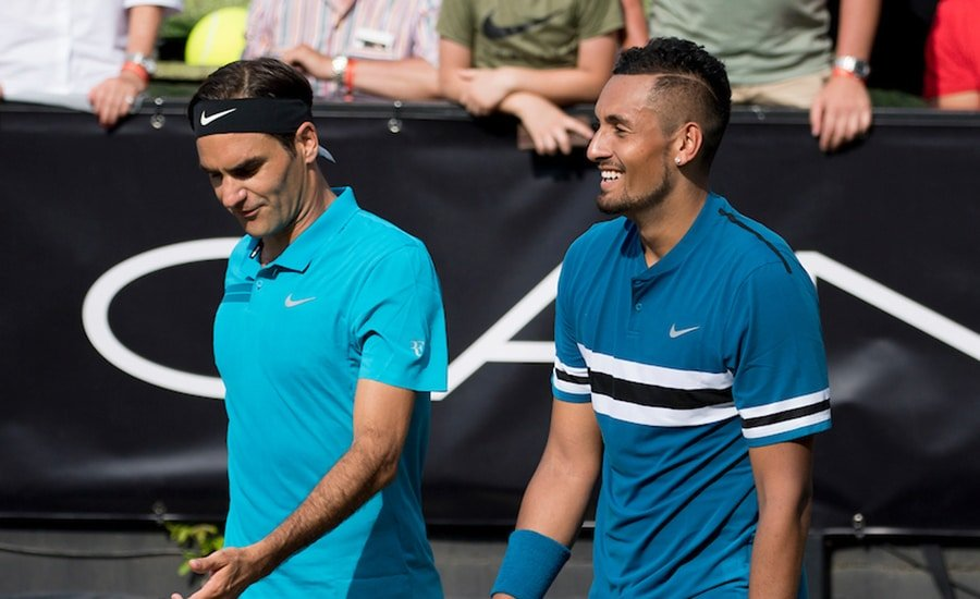 Nick Kyrgios and Roger Federer in discussion
