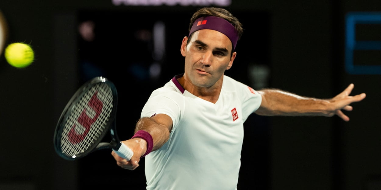 Roger Federer stretching for backhand