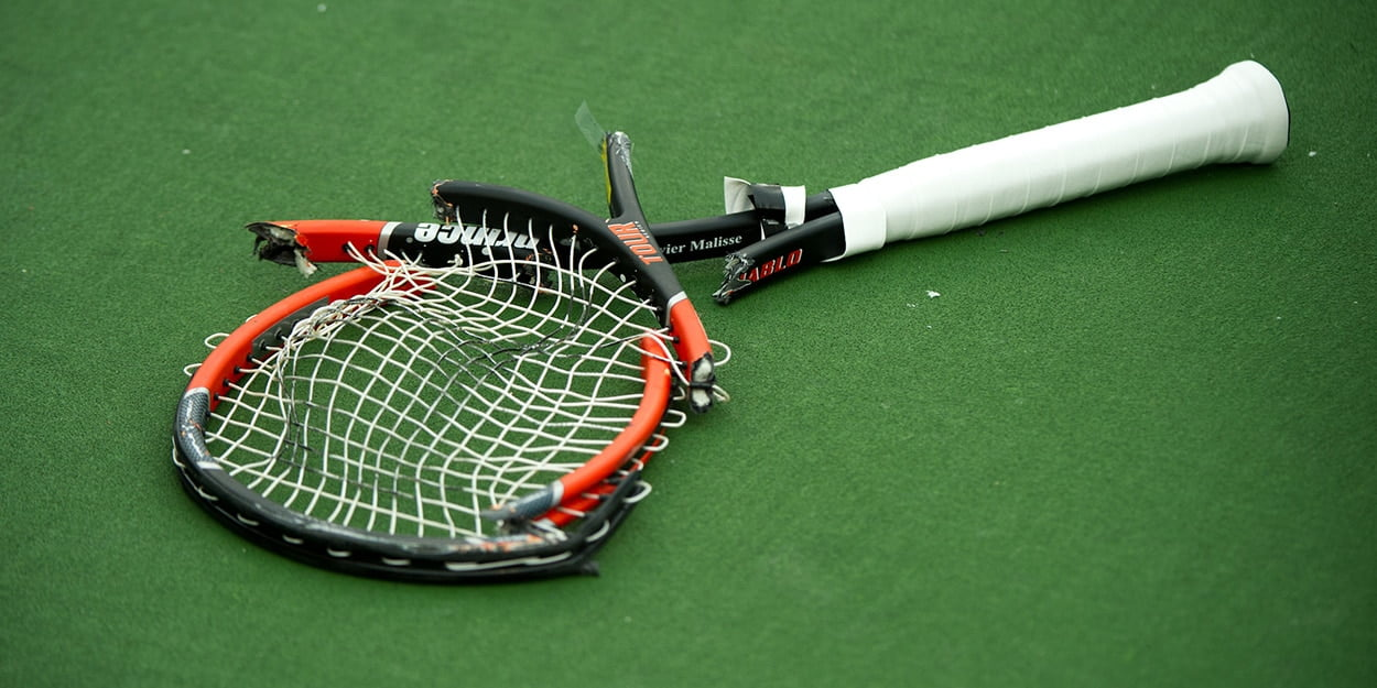 smashed tennis racket
