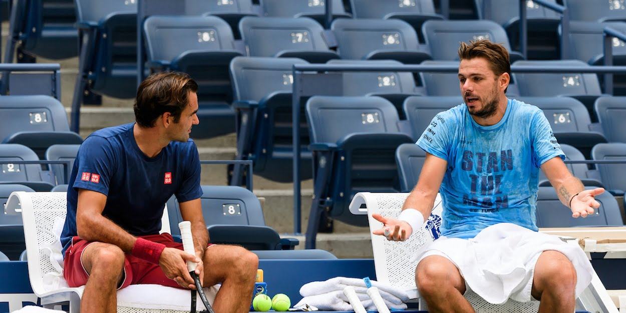 Roger Federer chats with Stan Wawrinka at practise